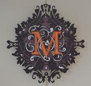 The logo of the Madden Museum of Art.