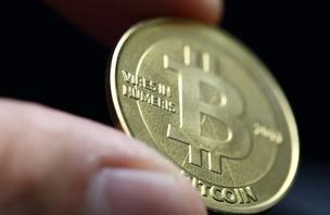 A bitcoin is arranged for a photograph in Tokyo, Japan, on Thursday, April 25, 2013. The digital currency, which carries the unofficial ticker symbol of BTC, was unveiled in 2009 by an unidentified programmer, or group of programmers, under the name of Satoshi Nakamoto. Supply is capped at 21 million Bitcoins and managed by a software algorithm embedded into the digital currency's design, rather than a monetary authority such as a central bank.