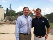 John Valentino and attorney Steve Diebenow stand in front of the demolished site.