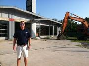 John Valentino stands in front of an old Shell gas station in Avondale where his future Mellow Mushroom will be built.