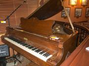 """This grand piano dates to 1929. """"There were a lot of great nights around this piano,"""" said auctioneer Paul Sobwick."""