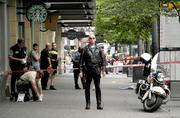 Police officers at the crime scene at 3rd Avenue in front of Benaroya Hall in the aftermath of the shooting of a bus driver on a Metro bus.