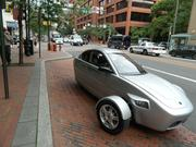 Elio Motors dropped by to show off its new concept car which can go 84 mpg (49 mpg city) and costs just $6,800.