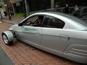 Elio Motors dropped by to show off its new concept car which can go 84 mpg (49 mpg city) and costs just $6,800. PBJ Advertising Director Ron Maver checks out the ride.