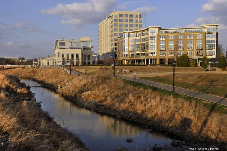 The Metropolitan development in midtown Charlotte is seen here with the Little Sugar Creek Greenway in the foreground.