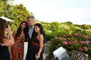Pari Bradlee, a yoga teacher, second from left, actor Alec Baldwin and his wife, Hilaria Thomas, also a yoga teacher.