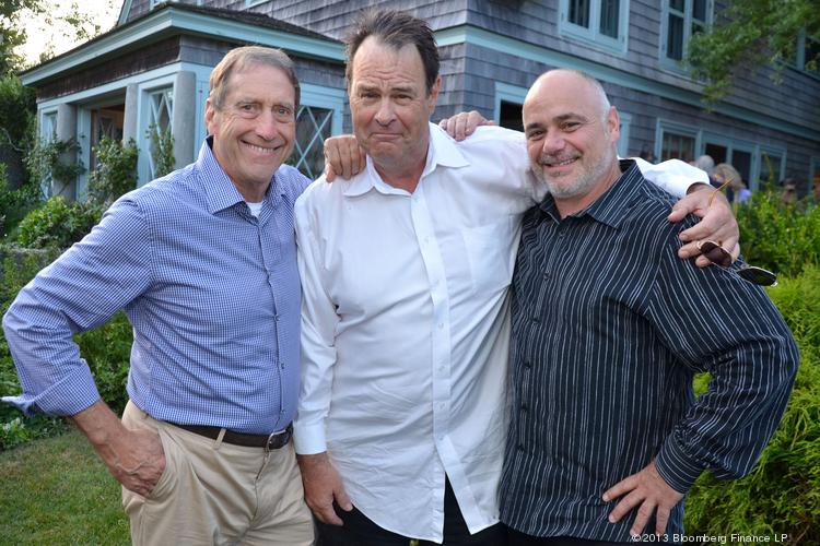 "Partners in Crystal Head Vodka, John Alexander, from left, Dan Aykroyd and David Brown, attend a gathering for the upcoming ""Yoga: The Art of Transformation"" exhibition, at the Grey Gardens estate in East Hampton, N.Y., on Aug. 9. The exhibition will open Oct. 19 at the Smithsonian's Freer and Sackler Galleries in D.C."