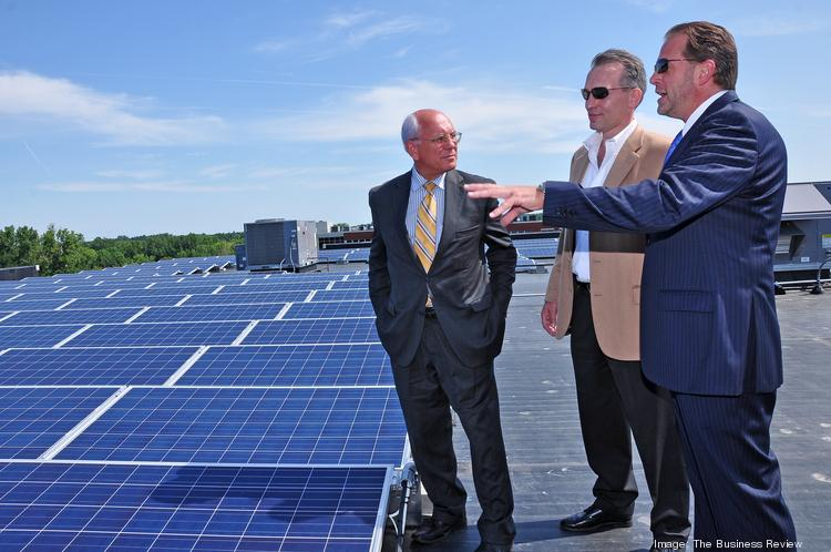 From left, U.S. Rep. Paul Tonko talks with Mark Fobare, president of Monolith Solar and vice president Steve Erby. Monolith recently completed a solar installation at 455 Patroon Creek Blvd. in Albany, NY.