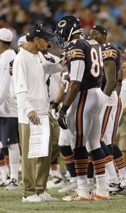 Chicago Bears head coach Marc Trestman, left, talks with Fendi Onobun during the second half of a preseason game against the Carolina Panthers in Charlotte, N.C.