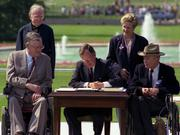 President George H.W. Bush signs the Americans with Disabilities Act on the South Lawn of the White House in 1990. Photo credit: George Bush Presidential Library and Museum