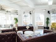 The space itself is 12,000 square feet and features a wraparound terrace and higher quality materials than WeWork, according to co-founders Charles Aini and Isaac Chetrit.
