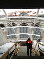 A construction worker stands on the steps from Regional Transportation District's underground bus terminal leading to the west side Denver Union Station. The terminal, which has 22 bus bays, is three blocks long and would be Denver's tallest building if stood up longways