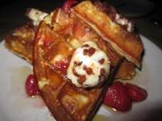 Belgian waffles with roasted strawberries, bacon butter and maple syrup