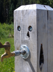 """A spigot dressed in a juniper casing provides a whimsical use for the wood, which has proliferated, growing by 10-fold in Eastern Oregon, over the last 150 years.  A new effort led by Tom Kelly and Martin Goebel could help the state overcome certain harvesting hurdles, such as high costs and what's so far been a """"lack of a steady supply of raw material to the manufacturers,"""" according to Oregon State University."""