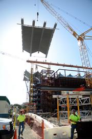 The workers in the foreground, the truss in the middle and the construction worker way at the top of the site give some interesting perspective to the construction site.