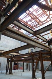 An intricate framework will support the stage inside the community theater.