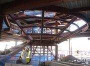 The framework of a giant spiral staircase is near completion.