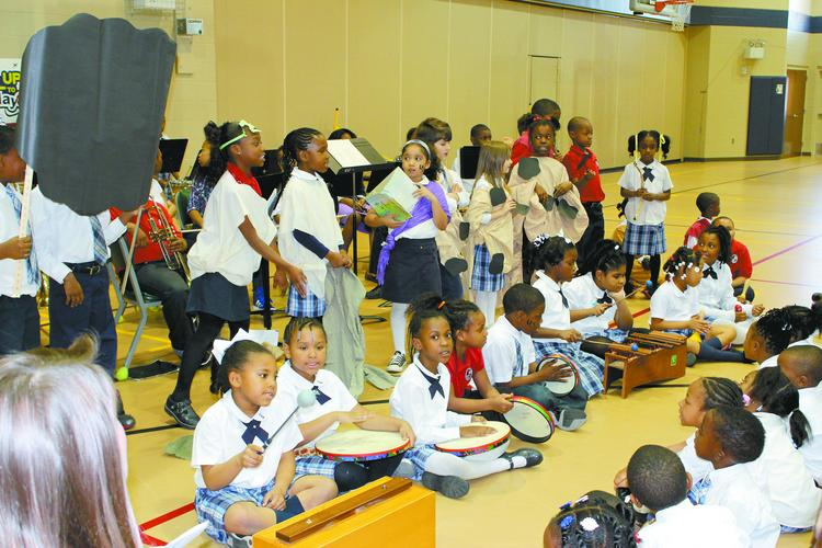 """Cornerstone second graders act out a scene from a Kenyan village to celebrate  """"Heritage Day."""""""