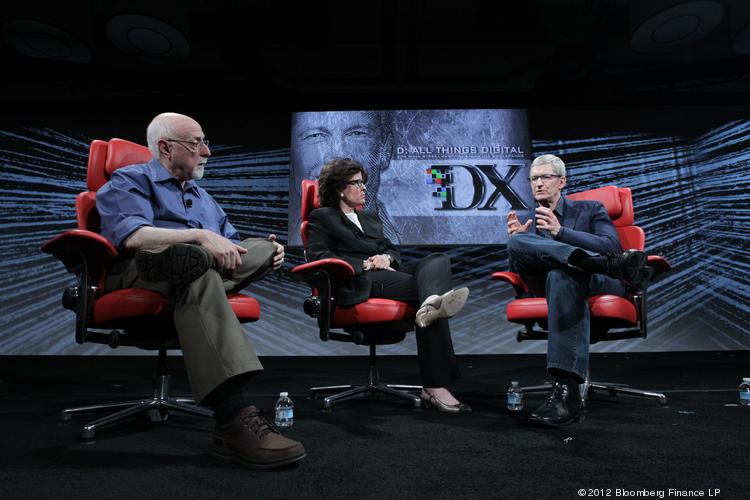AllThingsD co-founders Walt Mossberg and Kara Swisher speak with Apple CEO Tim Cook in 2012. The duo's influential tech site is now reportedly being shopped around at as much as a $60 million valuation.