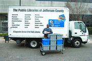 Jefferson County Library Cooperative Nonprofit category  10-word philosophy on community service: We strive to be a critical part of every citizen's life.  Click here to read their profile   Caption: A Jefferson County Library Cooperative courier getting ready to deliver books to 40 libraries.