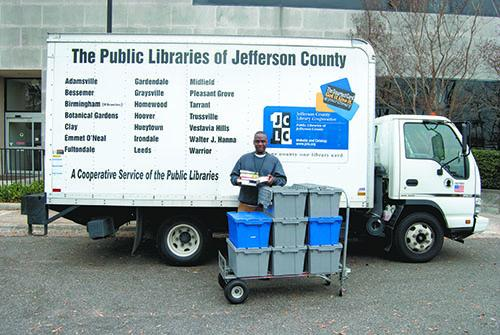 A Jefferson County Library Cooperative courier getting ready to deliver books to 40 libraries.