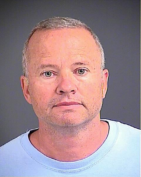 Chris Latham, seen here in a Charleston County Detention Center mug shot, has been charged in murder-for-hire plot in South Carolina. He has served as a Bank of America executive in the state.