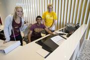 Left to right are freshman Linsy Townsend, junior engineering student Youssef Youssef, and Mary Kading, a junior studying social work. They will greet both residents and visitors to Manzanita Hall this coming semester, which kicks off next week.