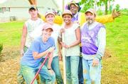 YWCA Central Alabama Nonprofit category  10-word philosophy on community service: We can only gain by giving back and making a difference in our community.  Click here to read their profile   Caption: The YWCA participated in building a playground in tornado-ravaged Pratt City.