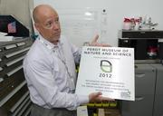 Perot Museum's Director of Facilities, Kenneth Cadenhead, shows the Green Globes plaque certifying it's highest possible ranking for sustainable building design