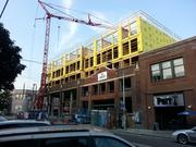 By incorporating the facades of old buildings into their projects, developers in the Pike/Pine corridor on Seattle's Capitol Hill can build bigger projects. This apartment project is on 11th Avenue at East Pine Street.