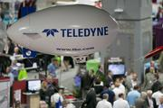 The Teledyne Technologies Inc. logo is seen above the exhibition floor at the Association for Unmanned Vehicle Systems International (AUVSI) unmanned systems conference in Washington, D.C., U.S., on Tuesday, Aug. 13, 2013. AUVSI is the world's largest nonprofit organization devoted exclusively to advancing the unmanned systems and robotics community.