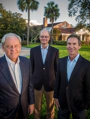 Aug. 14: Hallmark Partners Inc. (from left, principals Jeff Conn, Alex Coley and Bryan Weber) exclusively unveiled its plans for a 16-story condo luxury tower in Riverside to the Business Journal.