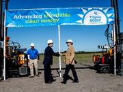 Florida Commissioner of Agriculture Adam H. Putnam shakes hands with Florida Power & Light President and CEO Eric Silagy after they drive pilings for the foundation of the future site of the company's Manatee Solar Energy Center in Parrish.