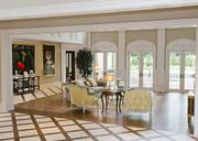 Patterned marble flooring in the formal living area looks out onto sunken courtyard and pool.