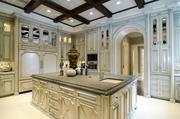 A well-equipped gourmet kitchen with custom refrigerator finish, island and Viking range.