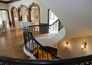 A three- story circular staircase off the kitchen and family room.