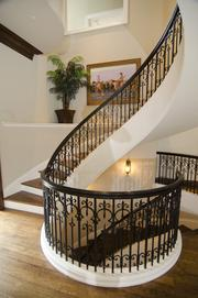 A three-story circular staircase off the kitchen and family room.