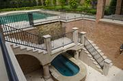 An oversize pool and waterfall feature at 10245 Strait Lane.