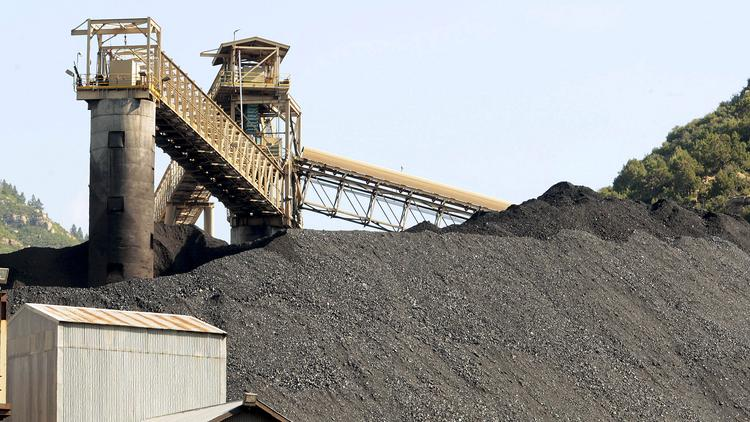 Extracted coal waits to be transported at a Colorado mining facility.