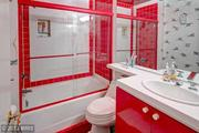 Another one of the house's four bathrooms — in case you really like red.