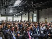 A sold-out crowd looks on during a panel discussion on the future of South Baltimore at City Garage on Friday.