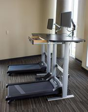 Treadmill workstations are available to Cerner employees who want to get a workout in at work.