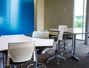 A whiteboard table and wall allow Cerner employees to sketch out ideas at the new campus.