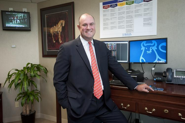 Josh Nagle, the Kentucky complex director for Merrill Lynch, is shown in his office.