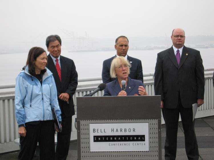 Sen. Patty Murray describes a plan to overhaul the way taxes are collected on import cargo in an event Thursday at the Port of Seattle. She's flanked by (left to right), Sen. Maria Cantwell, Port of Seattle CEO Tay Yoshitani, Port of Tacoma Executive Director John Wolfe, and Yakima Fruit Growers Association director Jon DeVaney.
