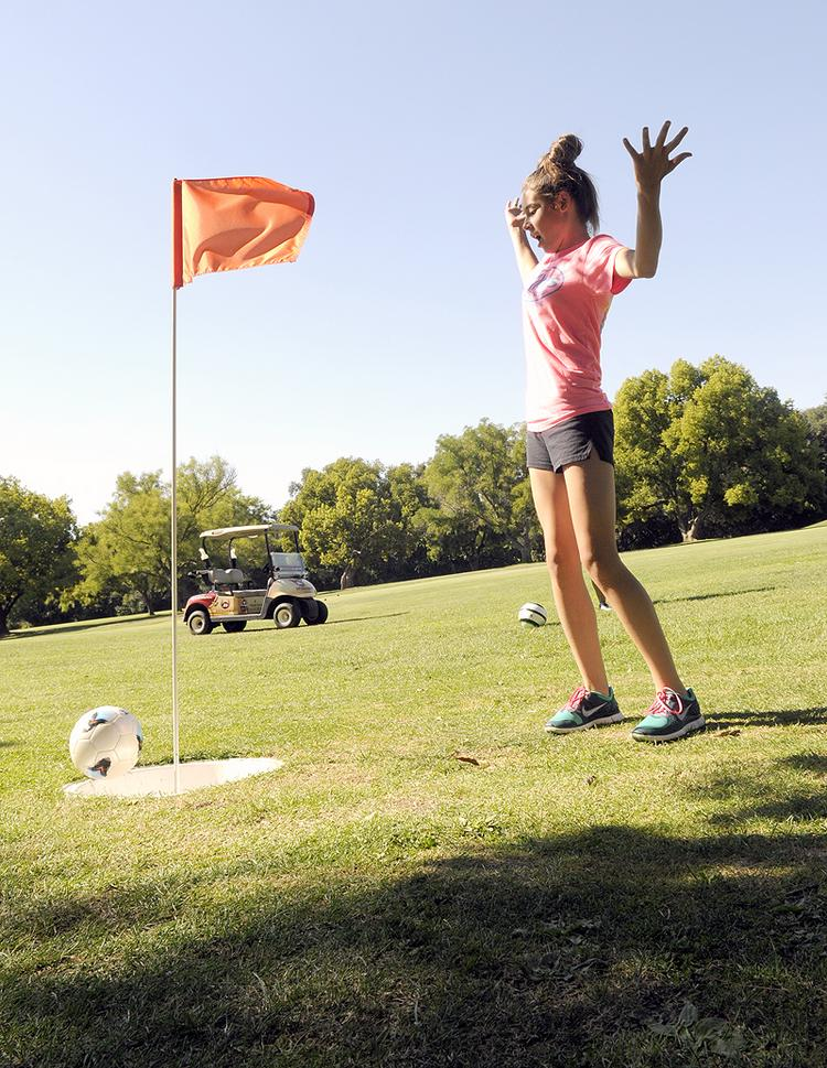 A FootGolf player cheers as a ball heads for the hole at Haggin Oaks.
