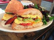 Breakfast sandwich with a side of mixed greens