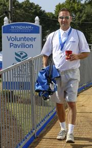 Wyndham volunteer Tyson Murphy leaves the volunteer pavilion headed to work the tee box at hole #8, sponsored by his employer, Edward Jones.