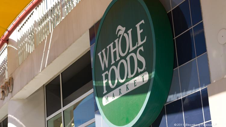 Whole Foods Market Inc. signage is displayed outside of a store in San Francisco, California, in this file photo. The Austin company is expected to release its second quarter earnings Tuesday after the markets close.