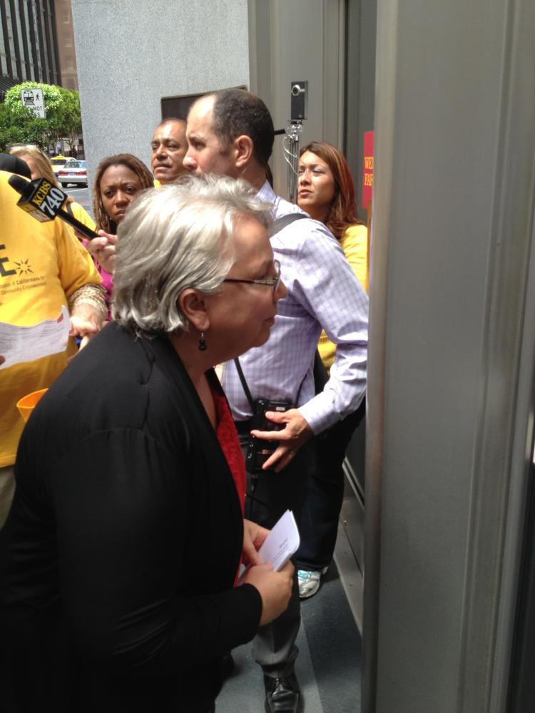Richmond Mayor Gayle McLaughlin found the doors locked at Wells Fargo's San Francisco headquarters Thursday. She was seeking a meeting with Wells CEO John Stumpf about the bank's lawsuit against the California city over its planned use of eminent domain to fight foreclosure blight.